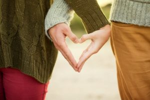 couples hands in the shape of love heart